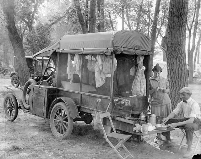 1918 Camper – Pull out picnic table and roll up curtains.
